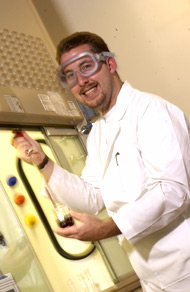 Photo of an Elon University student in a science lab.
