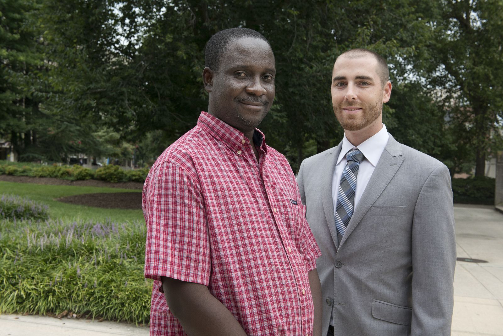 Elon Law clinic client Mandigo Vambe, left, and Elon Law alumnus Joe Baker