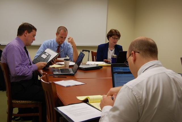 Students in Elon Law's Wills Clinic review documents with Professor Margaret Kantlehner