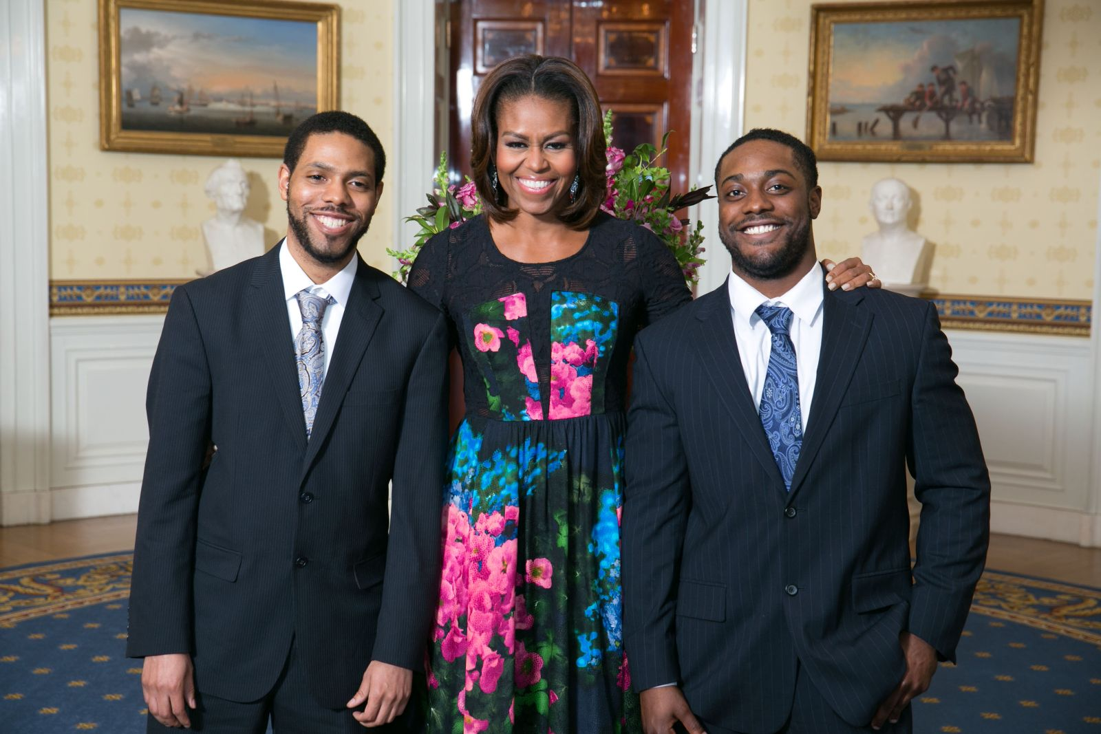 Elon Law student Tyrone Davis with First Lady Michelle Obama and guest
