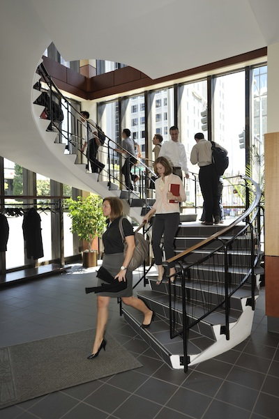 Students traverse the spiral staircase at Elon Law