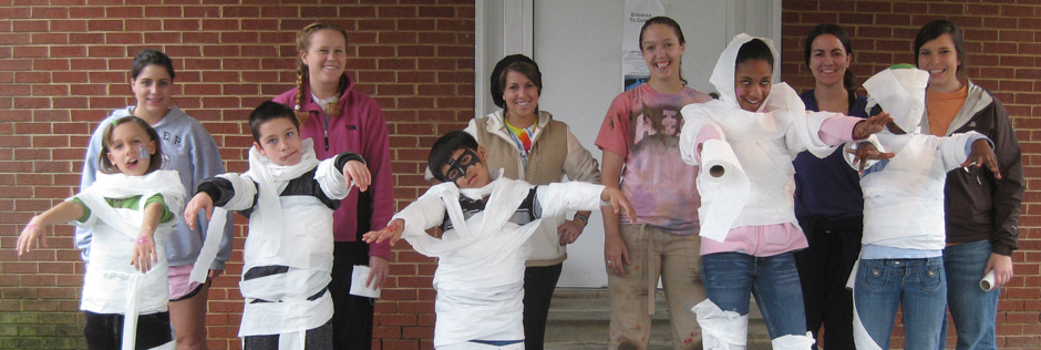 Students in a Qualitative Research Methods class and members of the APO Service Learning fraternity celebrate Halloween 2009 with children at the East Burlington Community Center. Photo credit Kim Jones.