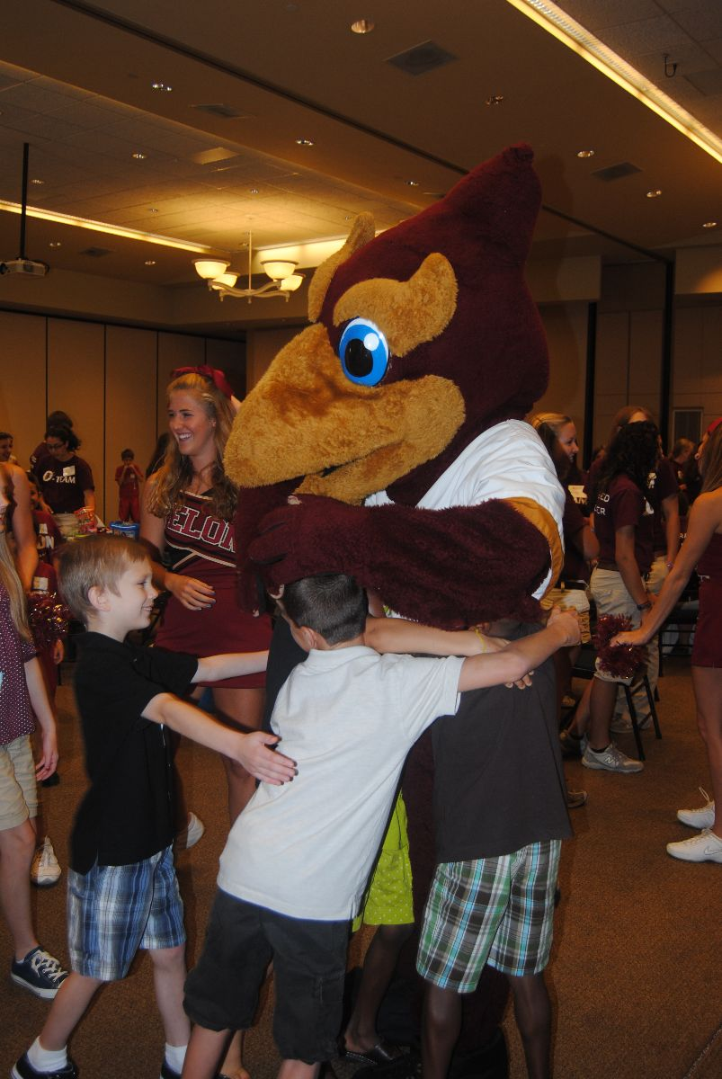 Siblings meet our Elon mascot, the Phoenix
