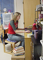 Photo of Elon University student in her dorm room.