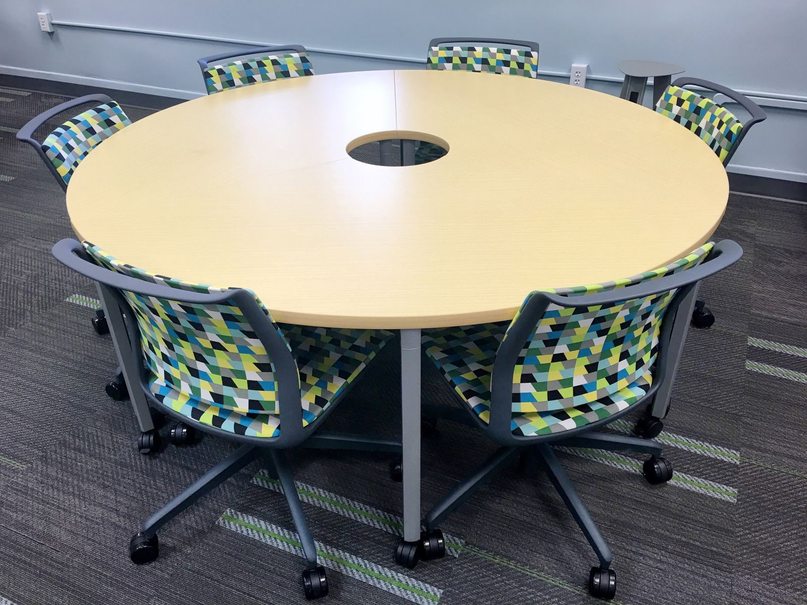 three pie/sectional tables that form a circle when placed together; six rolling chairs