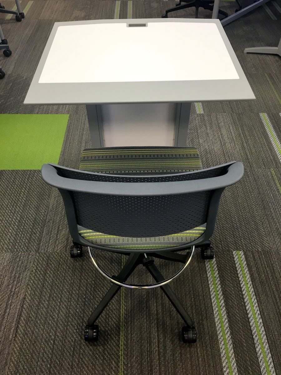 one height-adjustable instructor's podium, and one height-adjustable chair