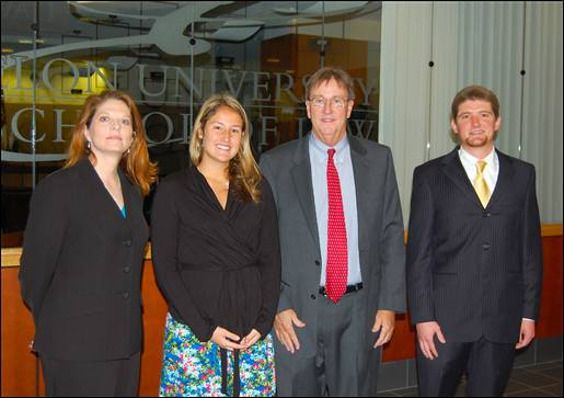 Election law expert John Wallace with members of the Elon student organization Law School Democrats