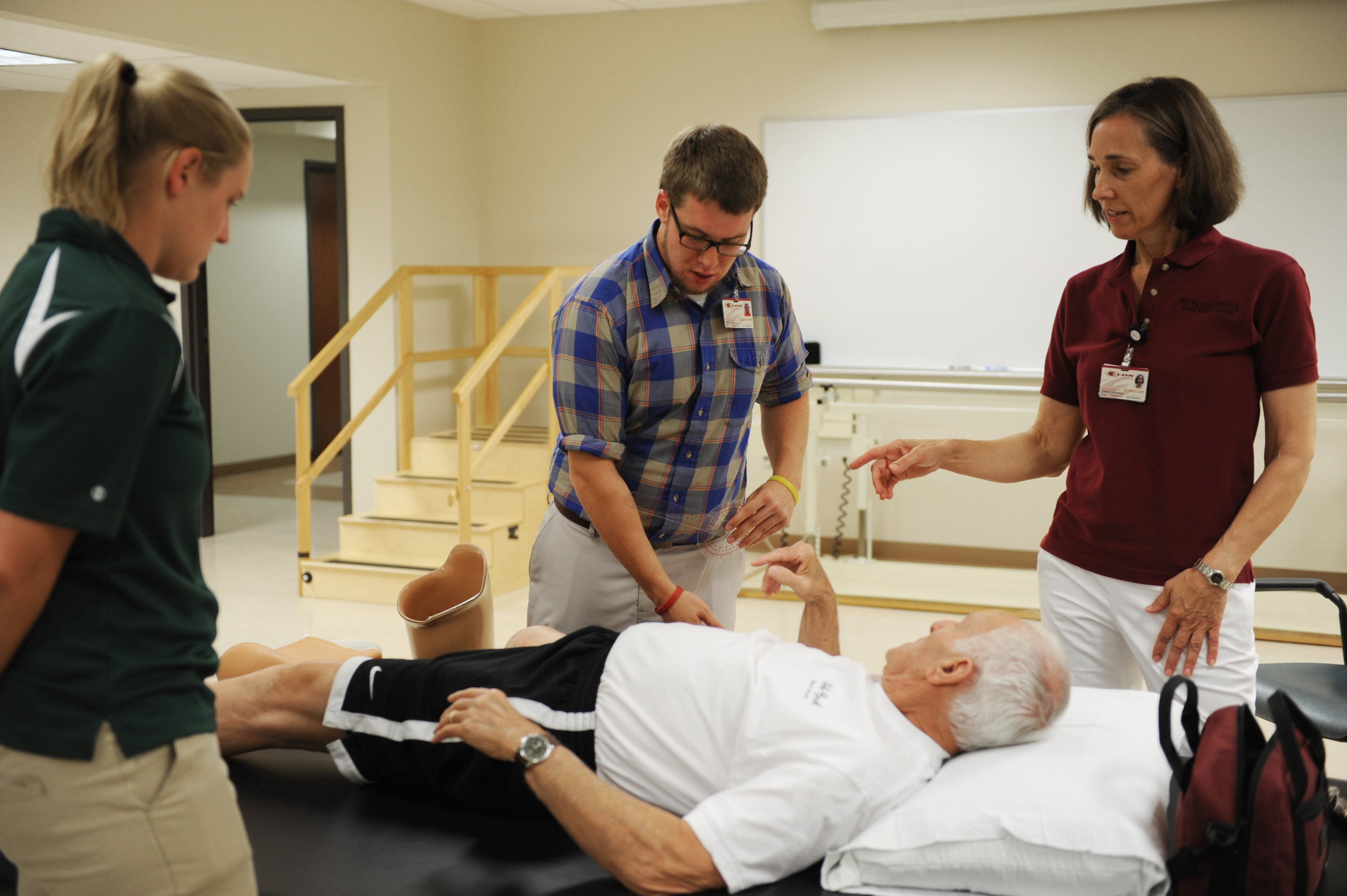 DPT professor Charity Johansson and students work with adults from the community as part of a clinical activity.