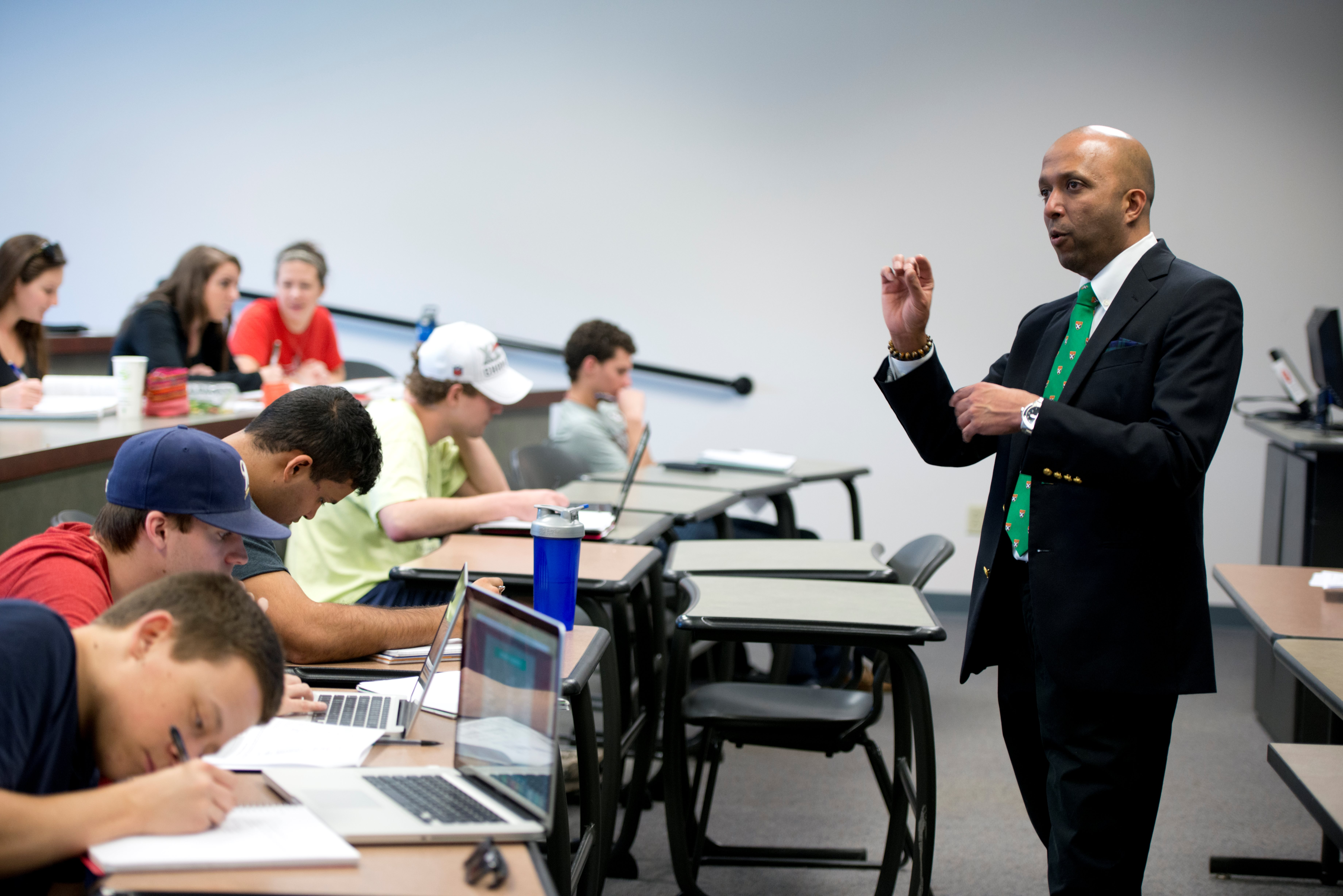 Raj Gupta, associate professor of finance and director of the William Garrard Reed Finance Center, teaches undergraduates in Koury Business Center.