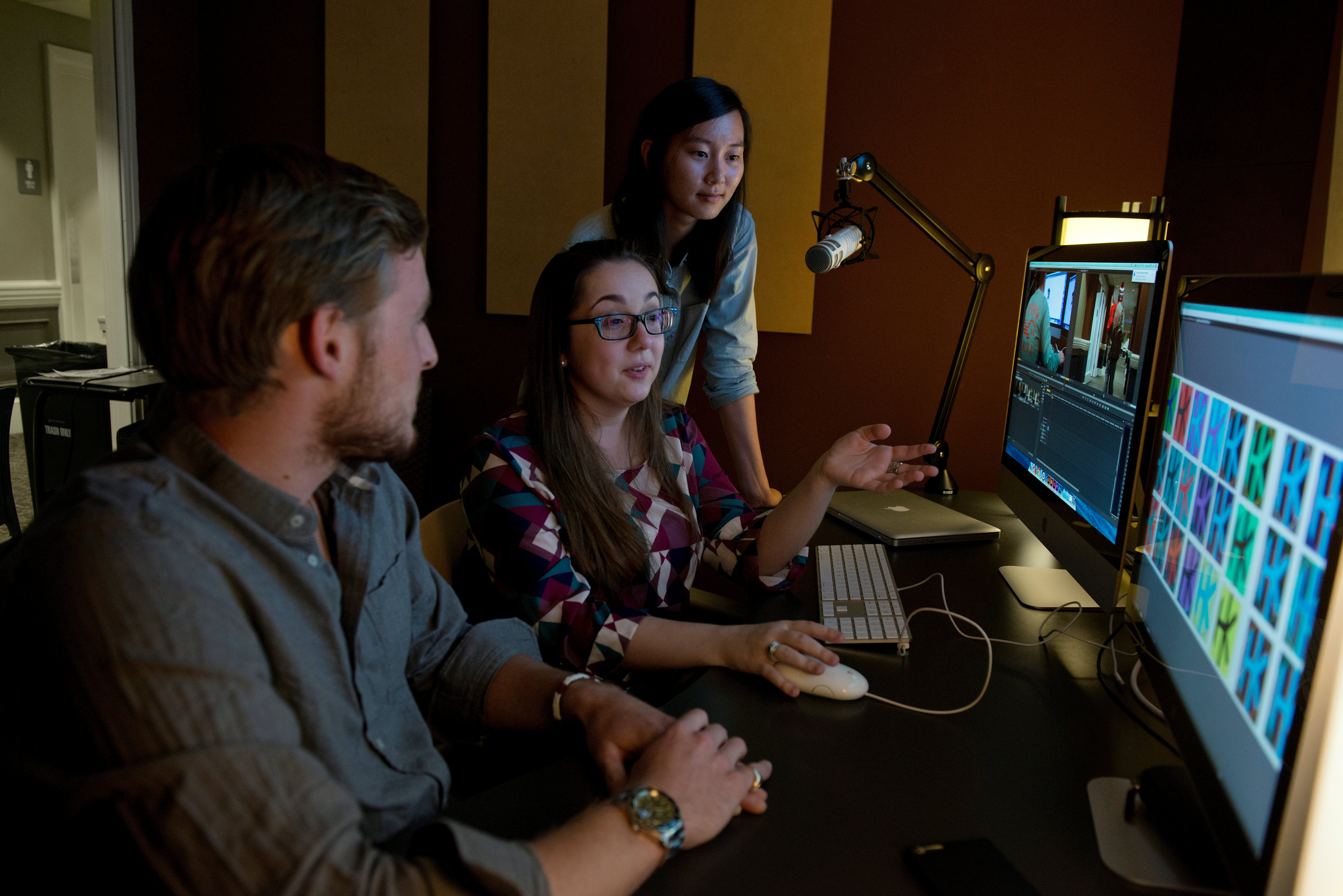 IMedia students work in one of the department's editing suites. Students, all graduating in 2015, are Anna Kim, Emily Yarborough (glasses), and Henry Kean.