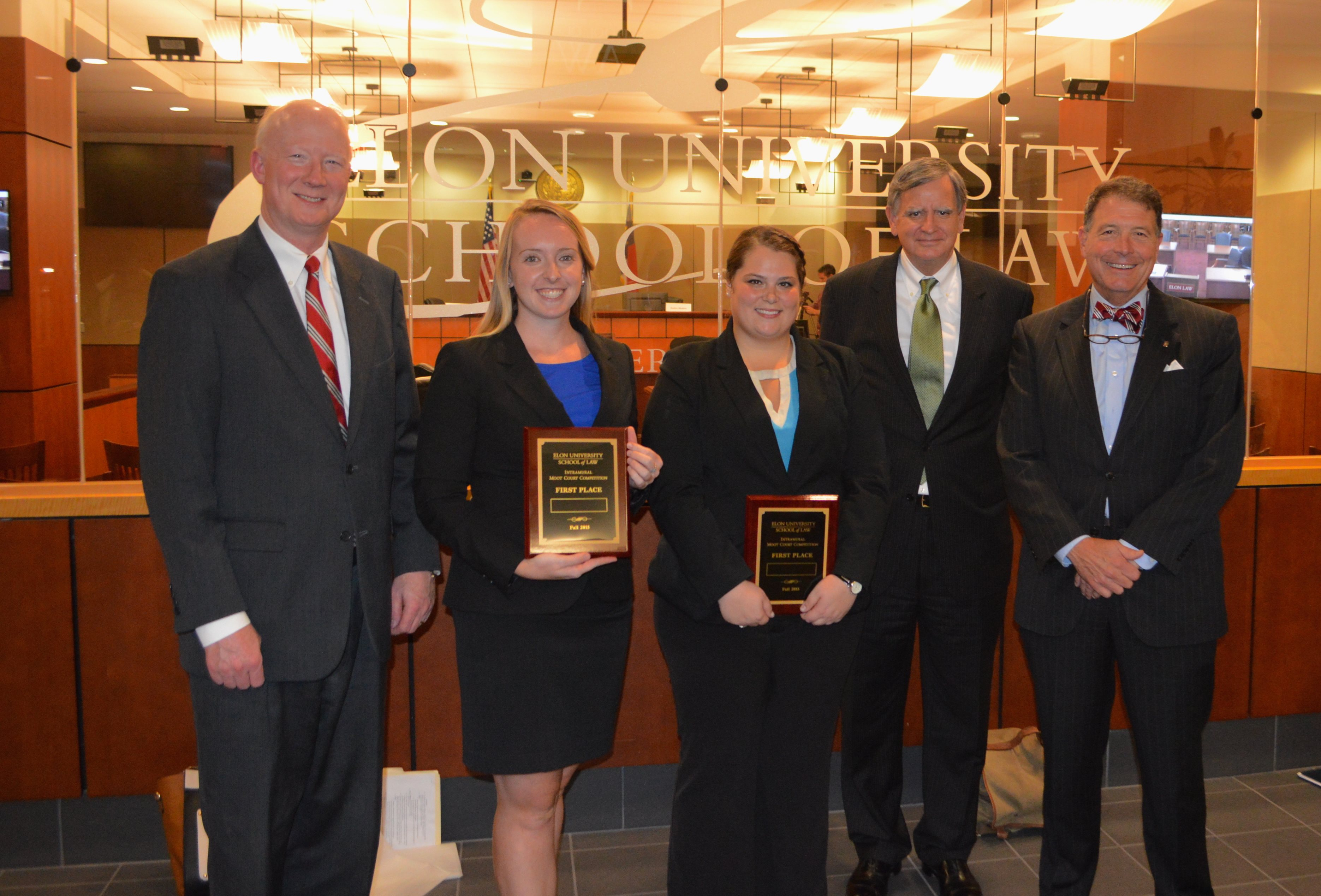 Elon Law moot court champions with final round judges